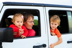 Family driving off-road car on tropical beach Royalty Free Stock Photos