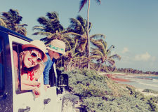 Family driving off-road car on tropical beach Stock Photography