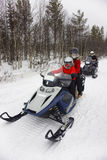 Family driving snowmobile in Ruka of Lapland Stock Images
