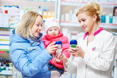 Family in drug store Stock Photos