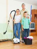 Family dusting with vacuum cleaner Stock Photography