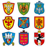 Family dynasty medieval royal coat of arms on shield vector set Stock Photos