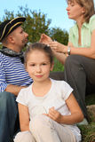 Family in early fall park. little girl in focus. Royalty Free Stock Photos