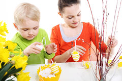 Family Easter- children decorates Easter eggs Stock Image
