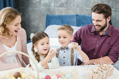 Family with easter eggs Stock Photo