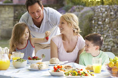 Family Eating An Al Fresco Meal Royalty Free Stock Image