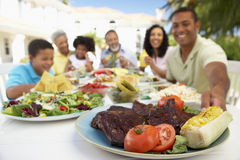 Family Eating An Al Fresco Meal Stock Image