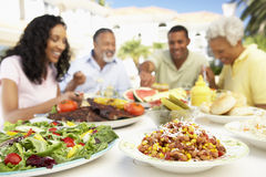Family Eating An Al Fresco Meal.  Royalty Free Stock Photos