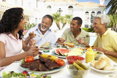 Family Eating An Al Fresco Meal Stock Photo