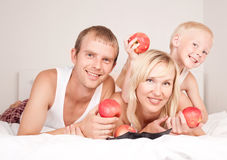 Family eating apples Royalty Free Stock Images