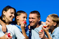 family eating apples Stock Images