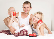 Family eating apples Royalty Free Stock Image