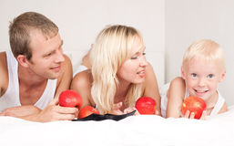Family eating apples Royalty Free Stock Photo