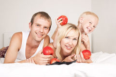 Family eating apples Stock Photography