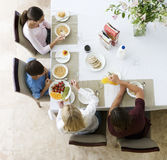 A family eating breakfast Stock Image