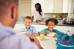 Family Eating Breakfast At Home Together. Sitting At Table Smiling Stock Images