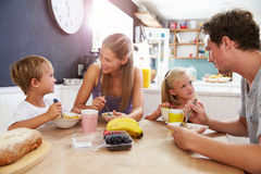Family Eating Breakfast At Kitchen Table Stock Photography