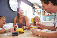 Family Eating Breakfast At Kitchen Table Royalty Free Stock Photography