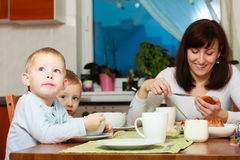 Family eating breakfast meal at the table Royalty Free Stock Photo