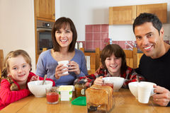 Family Eating Breakfast Together In Kitchen Stock Photo