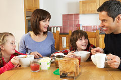 Family Eating Breakfast Together In Kitchen Royalty Free Stock Photography