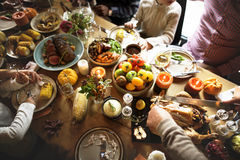 Family Eating Celebrating Thanksgiving Concept. Eating Food in the Thanksgiving Holiday Concept Stock Photo