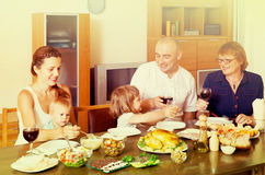 Family eating chicken at home Royalty Free Stock Photo