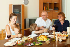 Family eating chicken at home Stock Photos