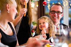 Family eating Christmas dinner at home Stock Photo