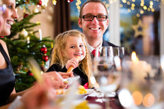 Family eating Christmas dinner at home Royalty Free Stock Photos