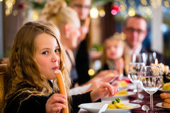 Family eating Christmas sausages for dinner royalty free stock image