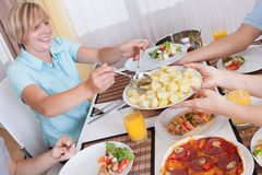 Family eating a cold lunch Stock Image