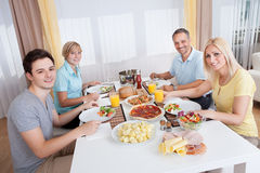 Family eating a cold lunch Stock Images