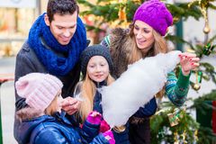 Family eating cotton candy on Christmas market Stock Images