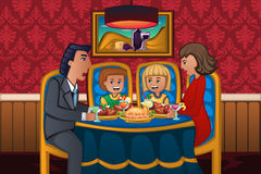Family eating dinner together Stock Image