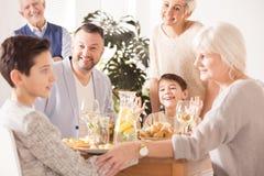 Family eating festive dinner Stock Photos