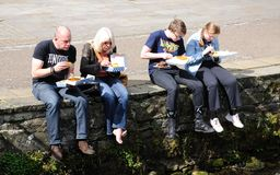 Family eating fish and chips. Royalty Free Stock Photo