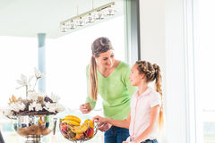 Family eating fresh fruits for healthy living Stock Photos