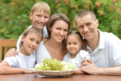 Family eating fruits outdoors Royalty Free Stock Image