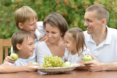 Family eating fruits outdoors Stock Photo
