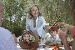 Family Eating At Garden Table Royalty Free Stock Photo