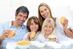 Family eating hamburgers Royalty Free Stock Photo