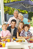 Family eating healthy with salad Stock Image