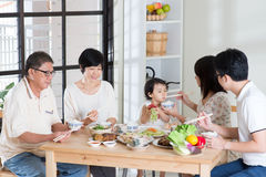 Family eating at home stock images