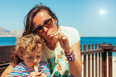 Family eating ice cream against of sea royalty free stock photo