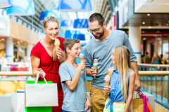Family eating ice cream in shopping mall royalty free stock photo