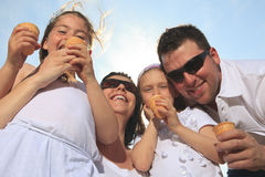 Family eating ici-cream in front of ocean Stock Image