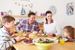 Family Eating Lunch At Kitchen Table Stock Photo