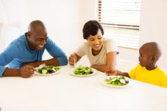 Family eating meal. Happy african american family eating meal together Royalty Free Stock Image