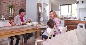 Family Eating Meal In Kitchen Together stock footage